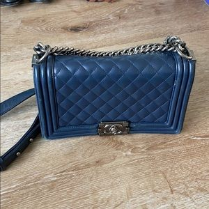 Used blue leather chain purse